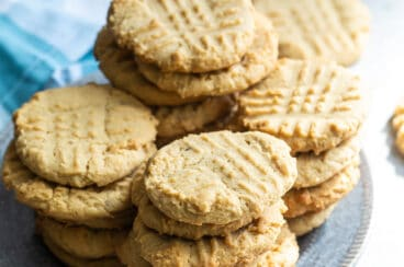 Peanut butter cookies stacked on a blue plate.