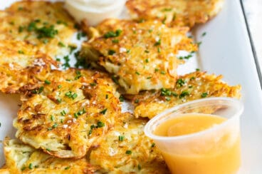 Potato latkes on a rectangular platter.