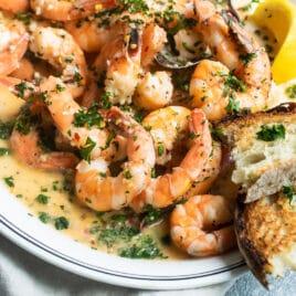 Shrimp scampi on a white platter.