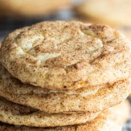 A stack of Snickerdoodle cookies on a baking rack.