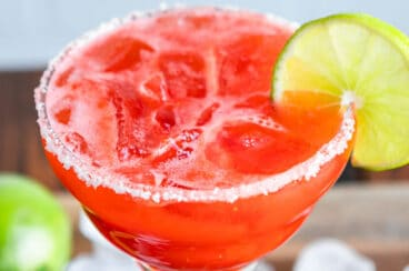 A strawberry margarita on the rocks.