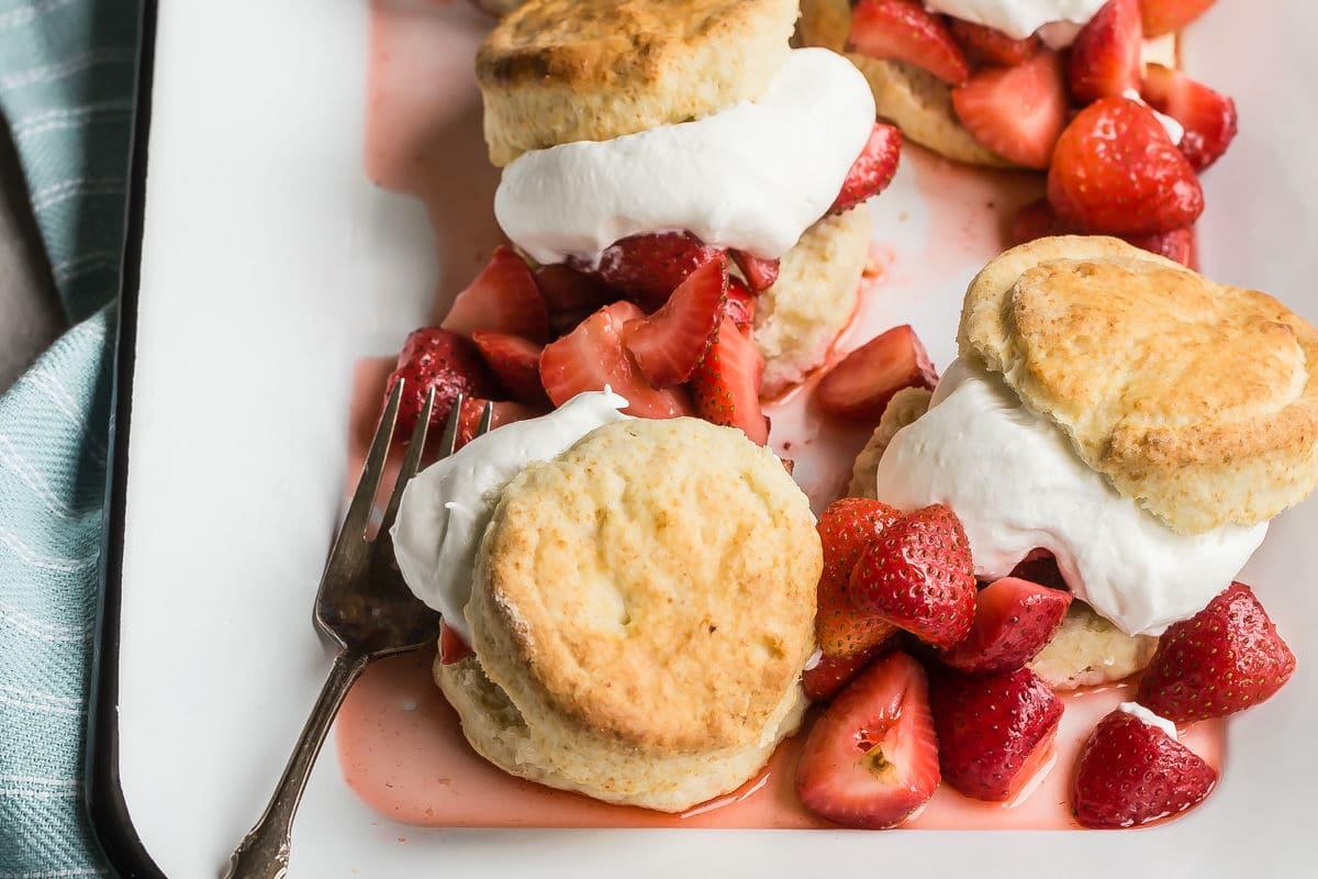 Strawberry shortcakes on a white platter.