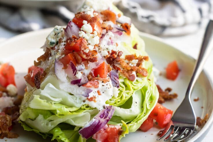 A wedge salad on a plate.