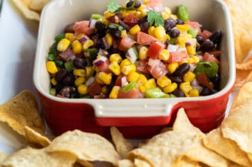 Black bean salsa in a red square dish.