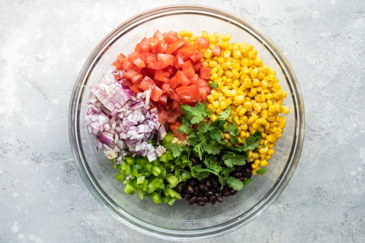 Black bean salsa ingredients in a bowl.