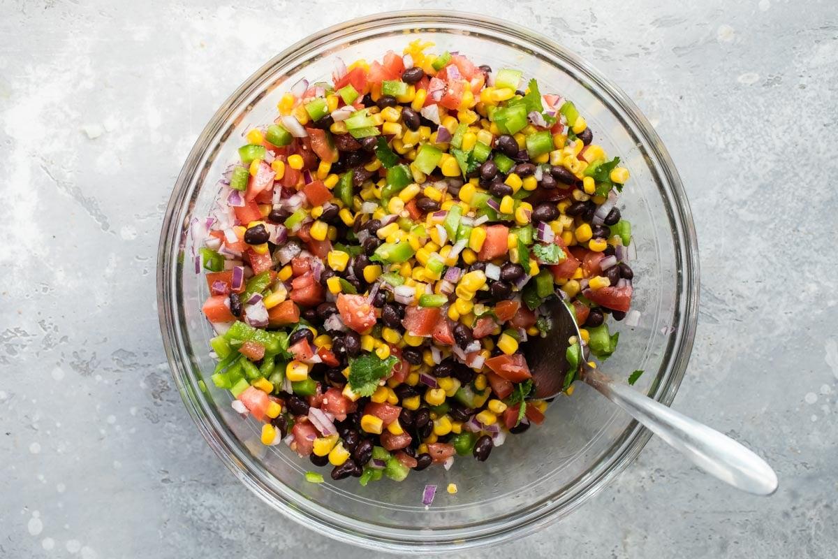 Black bean salsa in a clear glass dish.