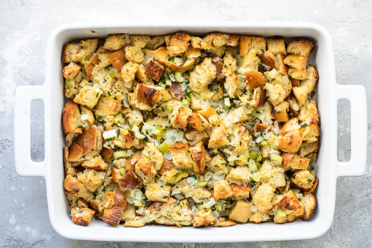 Bread stuffing in a baking dish after baking.