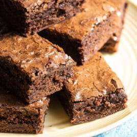 Brownie squares on a yellow circle plate.