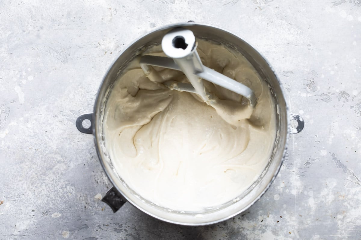 Bunny cake batter in a silver mixing bowl.