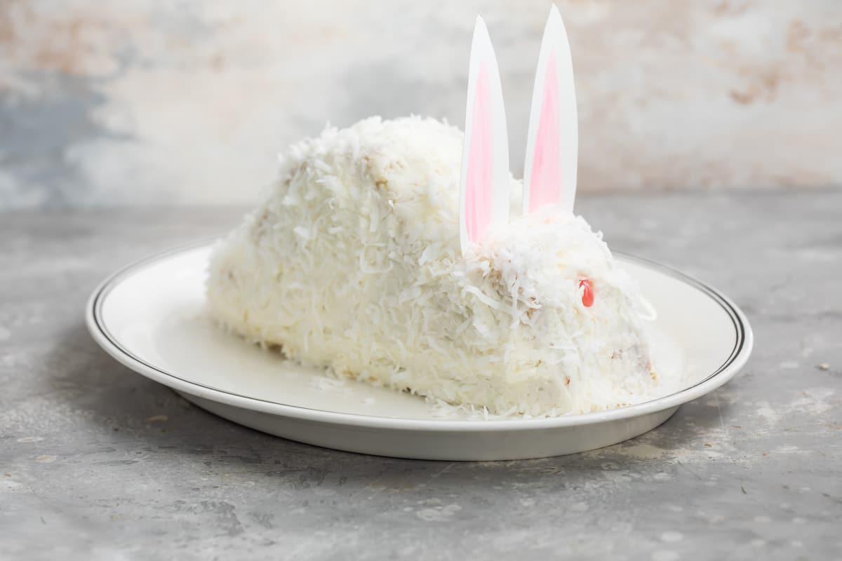 A bunny cake on an oval plate.