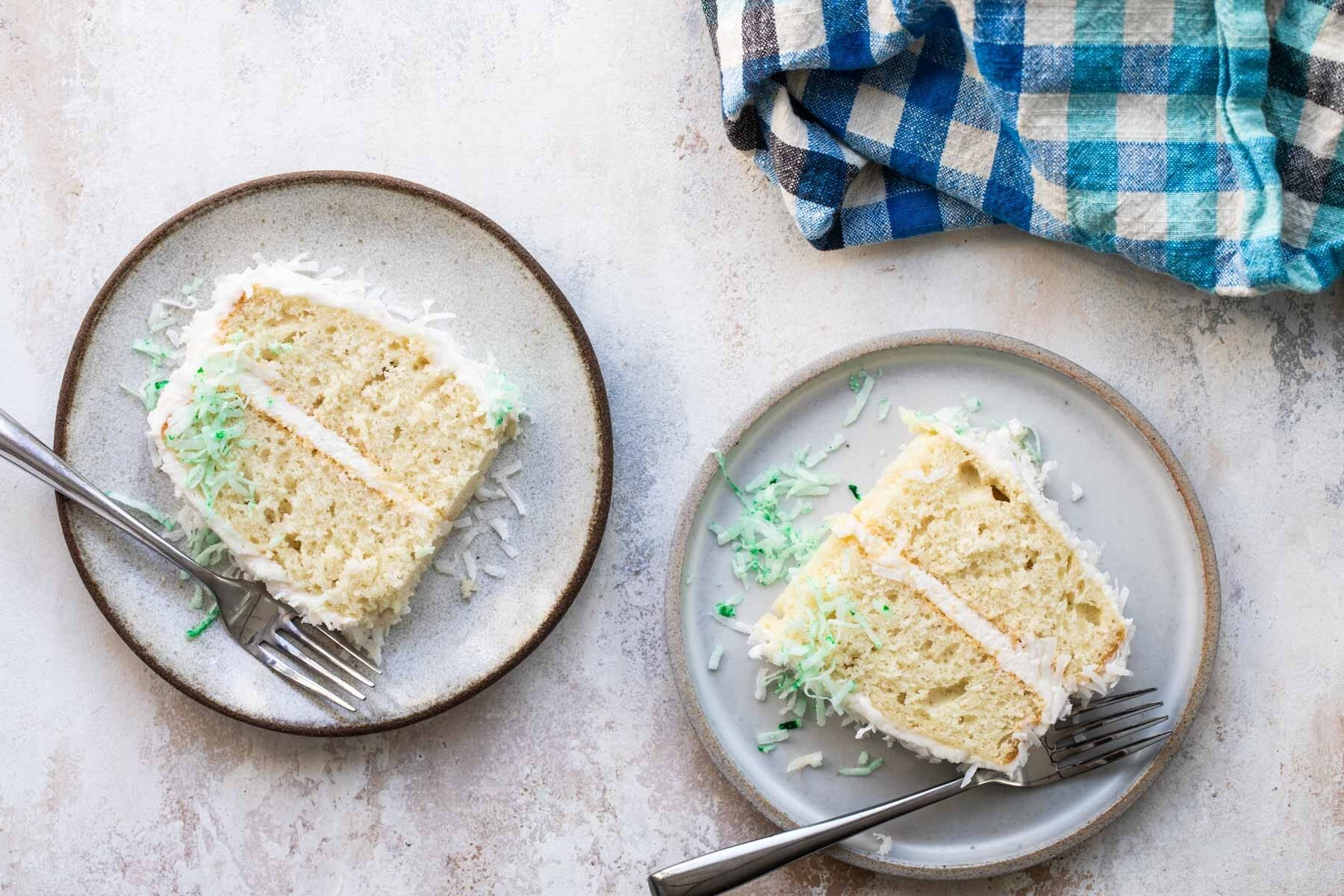 Two plates with slices of bunny cake on them.