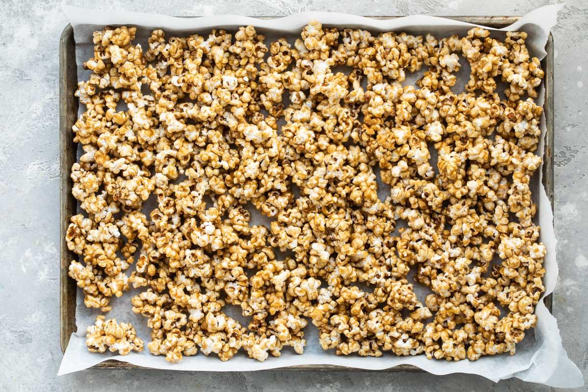 Caramel corn on a baking sheet.