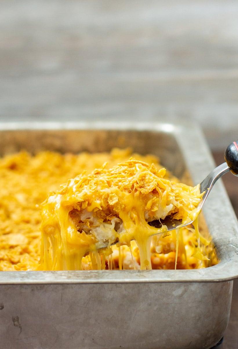 Cheesy potato casserole in a baking dish.