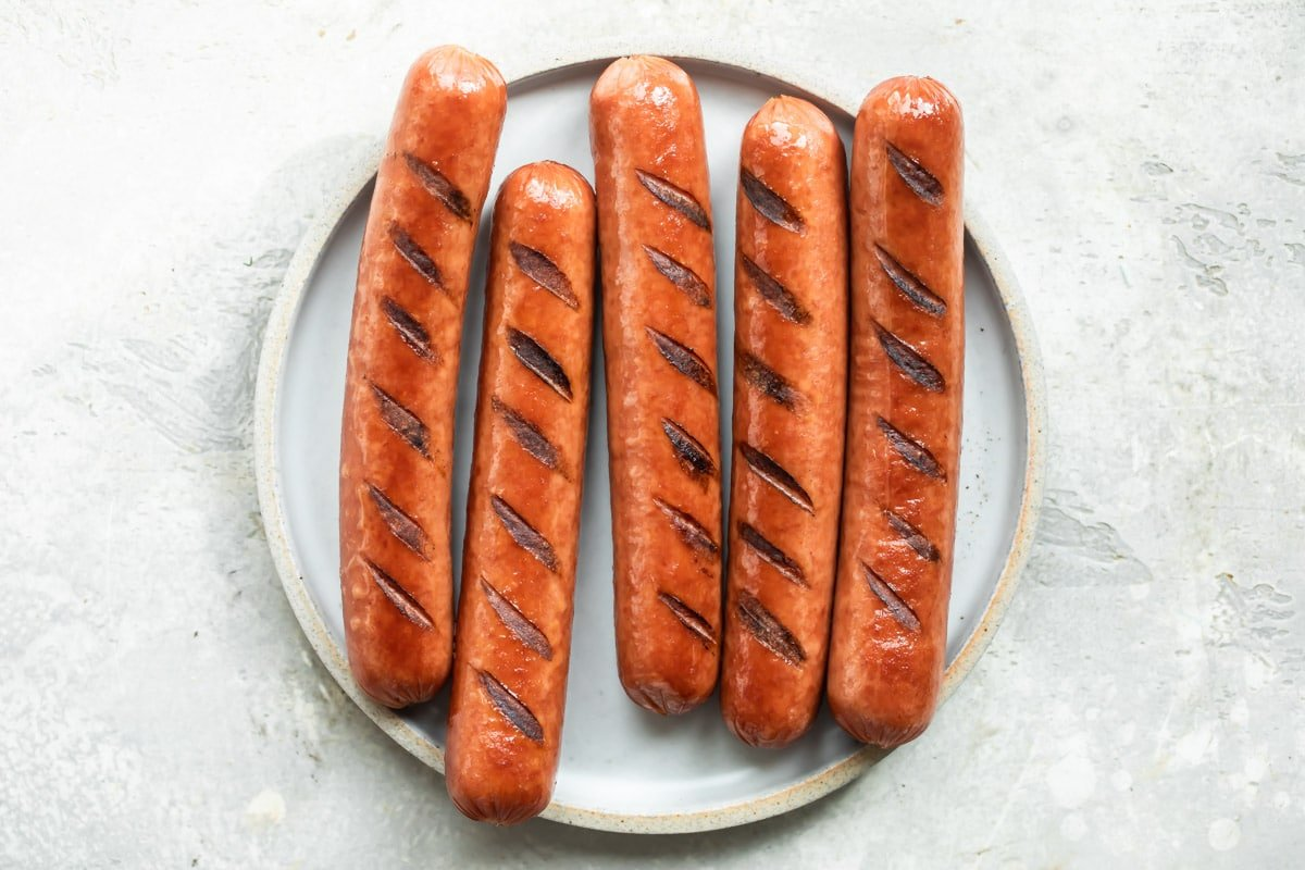 A plate of grilled hot dogs.