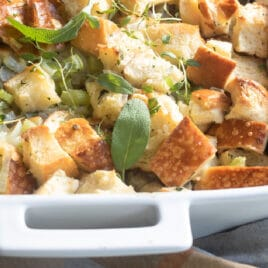 Classic bread stuffing in a white baking dish.
