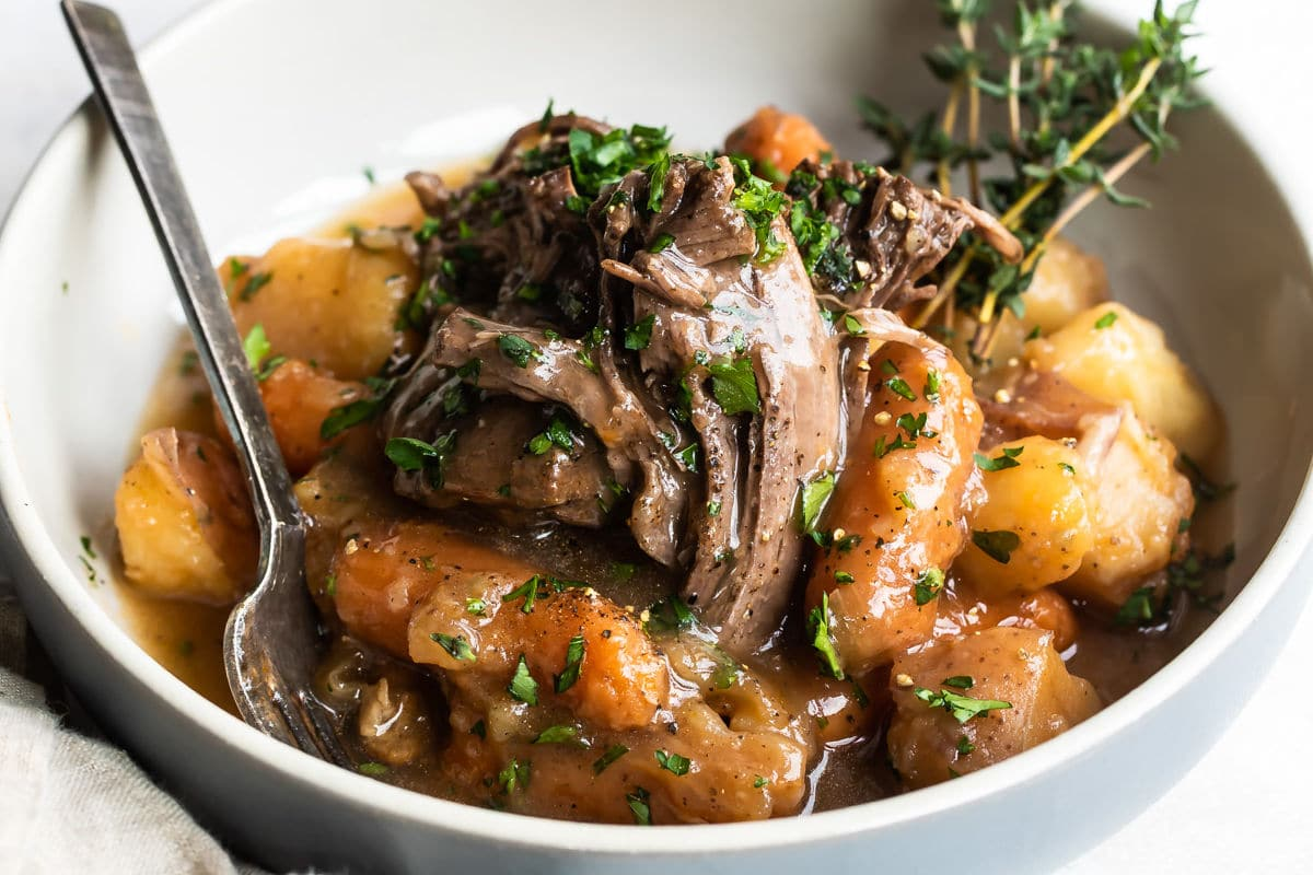 Pot roast and vegetables in a bowl.