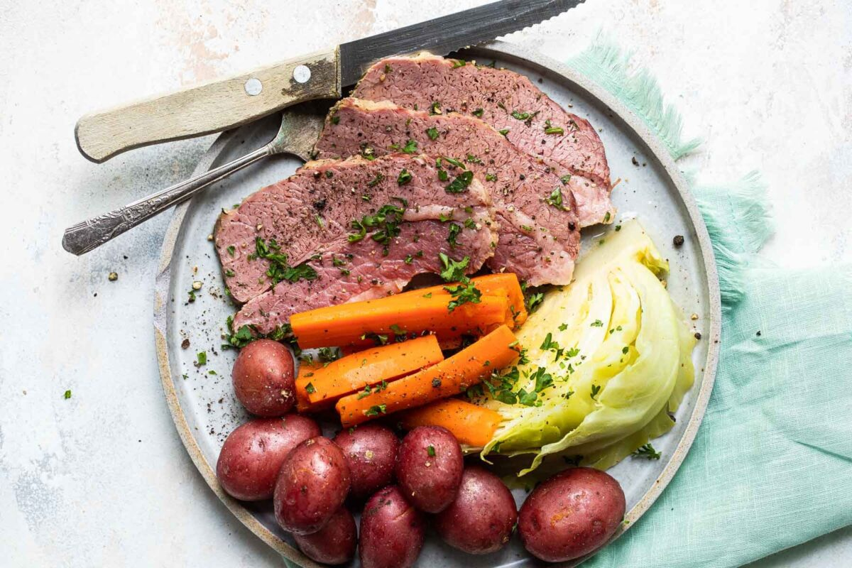 Corned beef, cabbage and potatoes on a round platter.