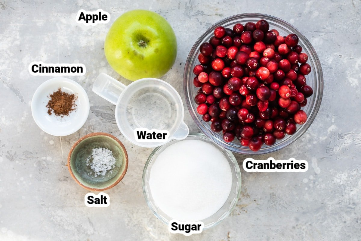 Cranberry Sauce ingredients labeled and in various bowls.