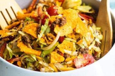 A white bowl filled with Dorito Taco Salad.