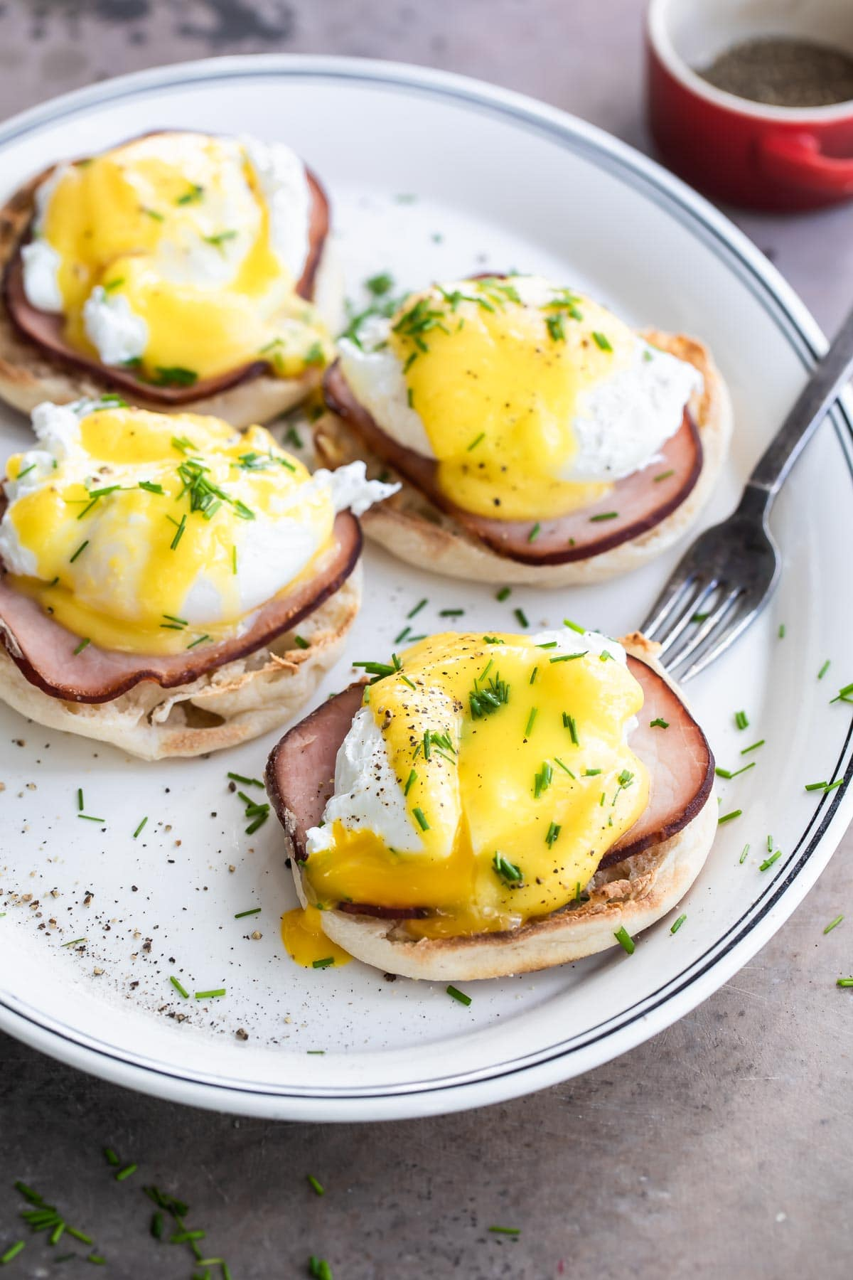 Eggs benedict on a white plate.