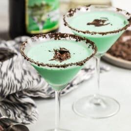 Two grasshopper cocktails in martini glasses.