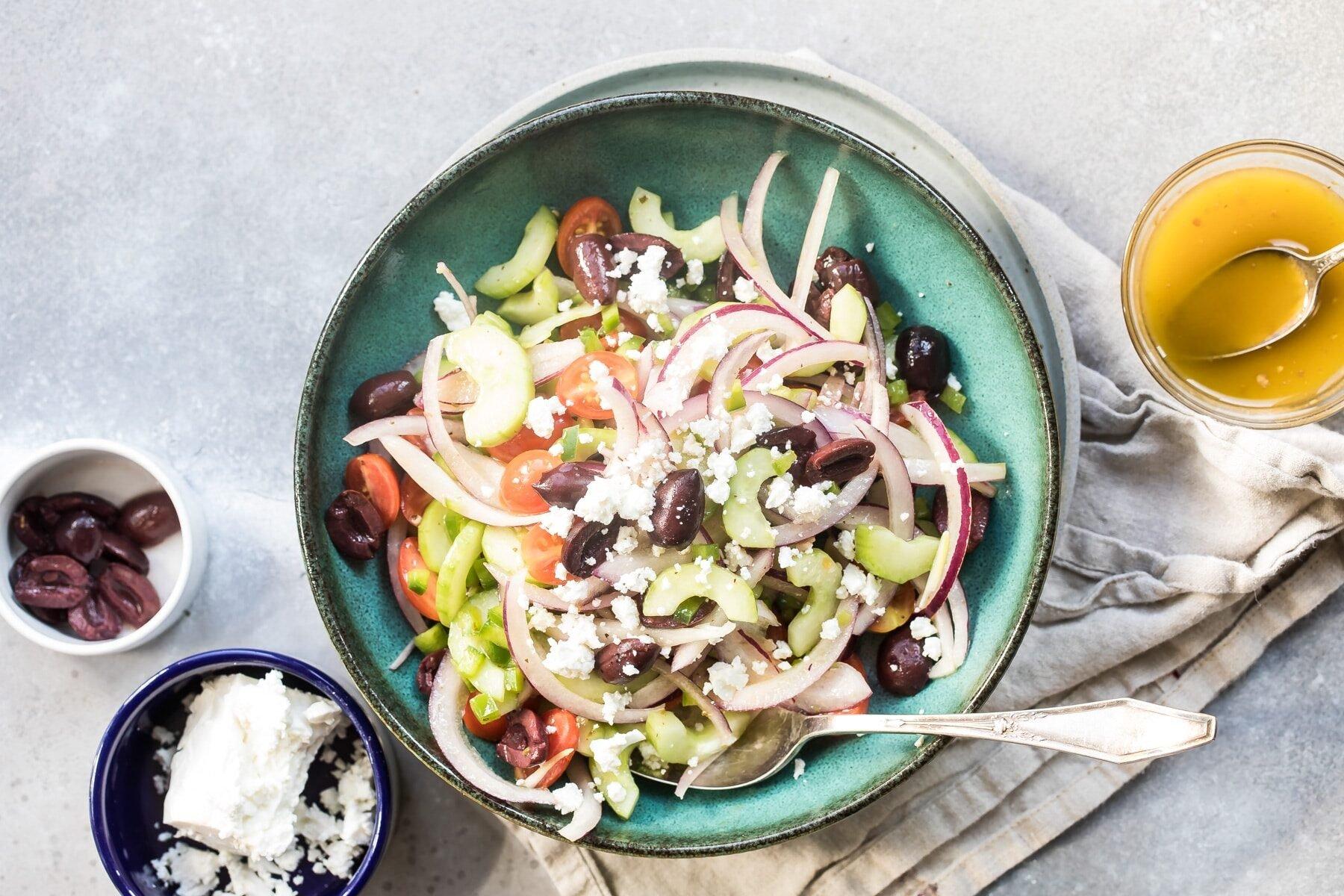 Greek salad in a blue bowl. .