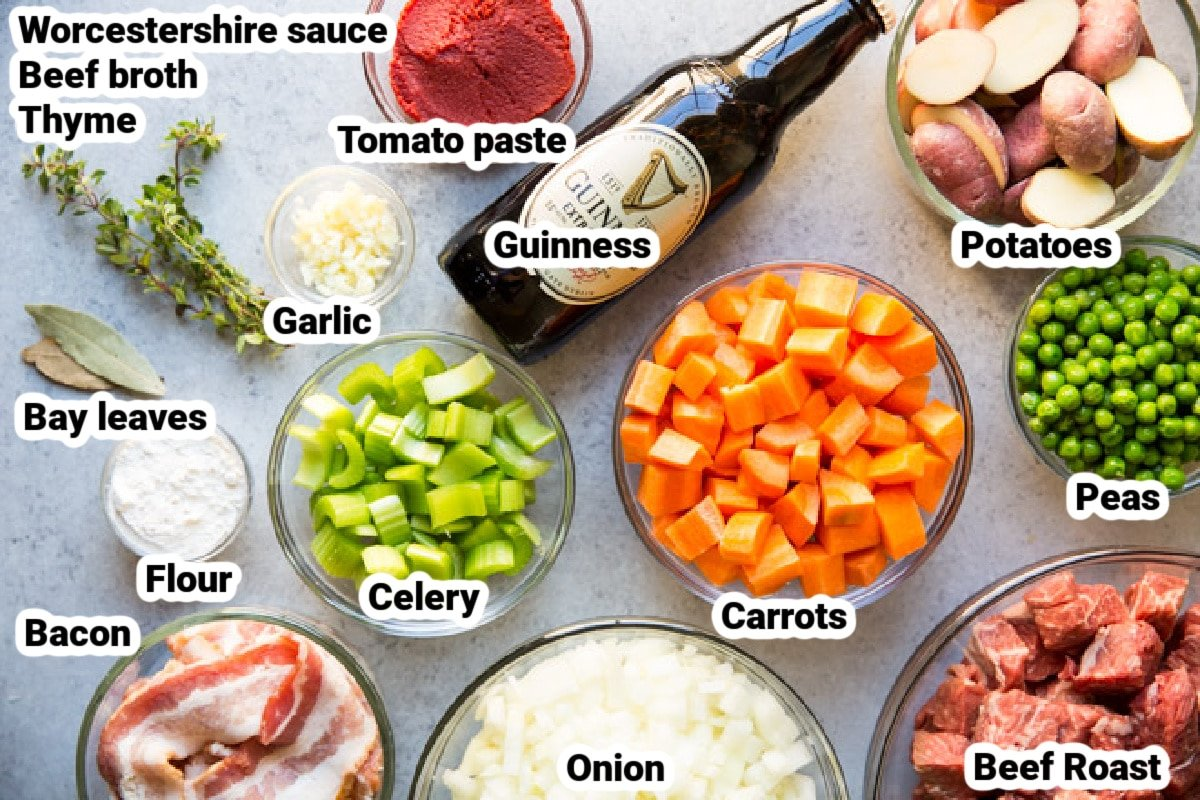 Labeled ingredients for Guinness Stew in various bowls.
