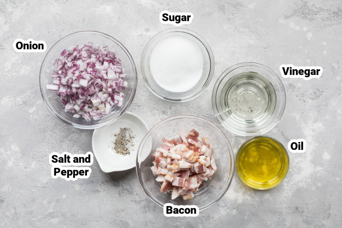 Labeled ingredients for hot bacon dressing in various bowls.