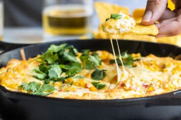A skillet with hot corn dip.