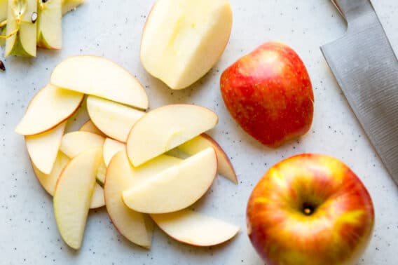 Apple slices on a cutting board.