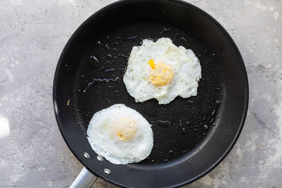 Eggs over easy in a skillet.