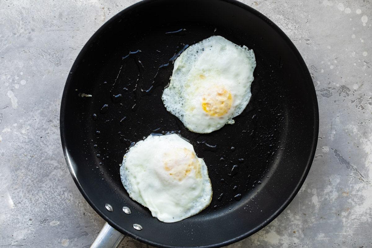 Eggs over medium in a skillet.