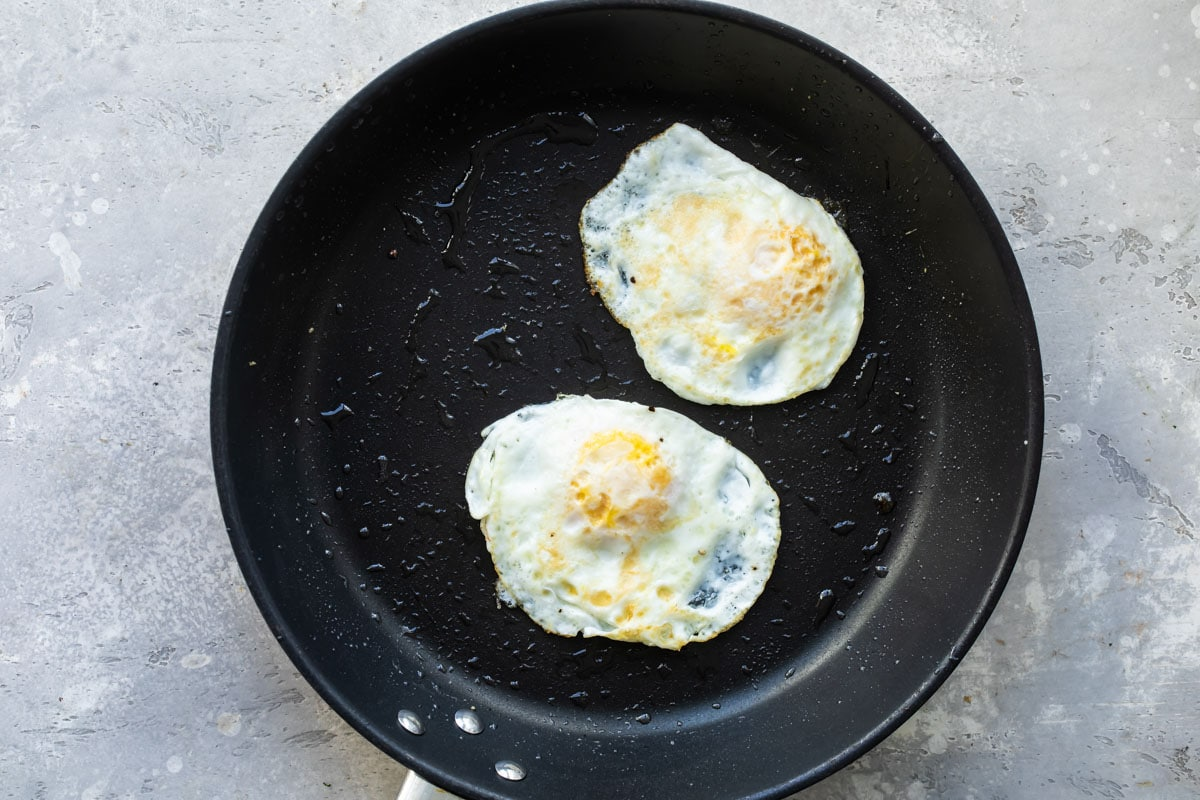 Eggs over hard in a skillet.