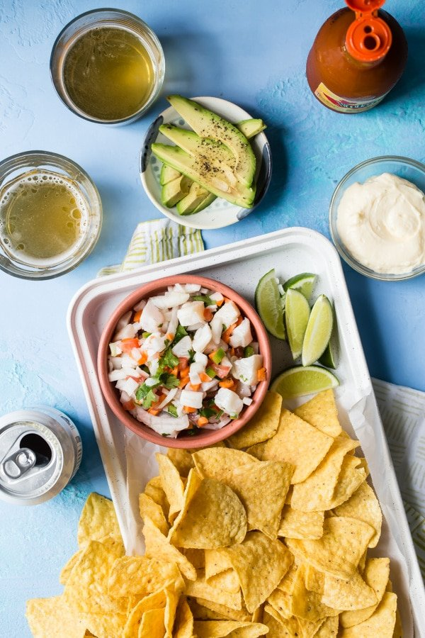 Tilapia ceviche in a bowl with chips.