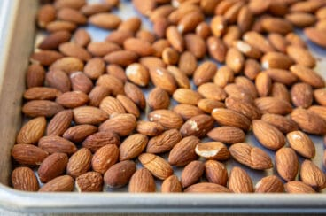 Whole almonds on a baking sheet.