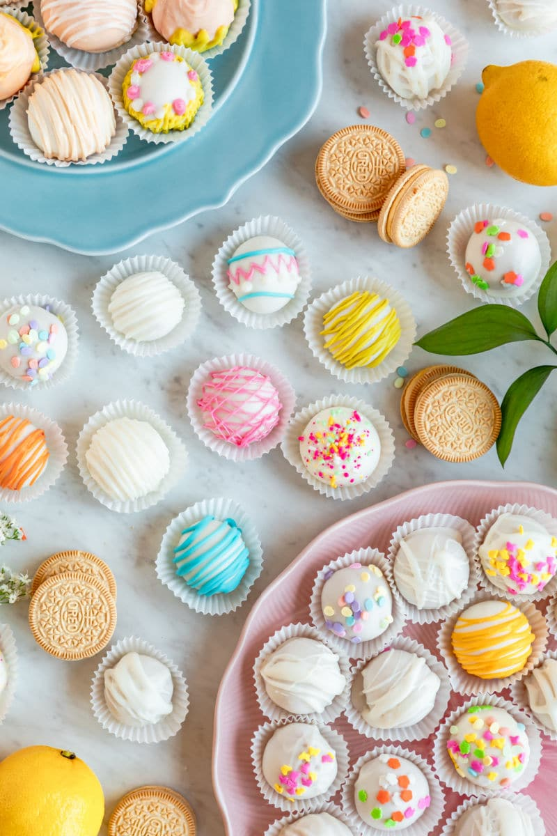 Lemon cookie balls decorated and arranged on a table.