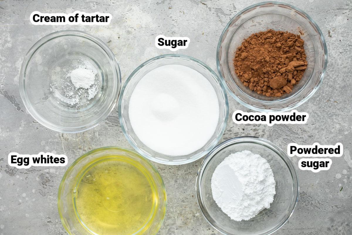 Labeled meringue mushroom ingredients in various bowls.