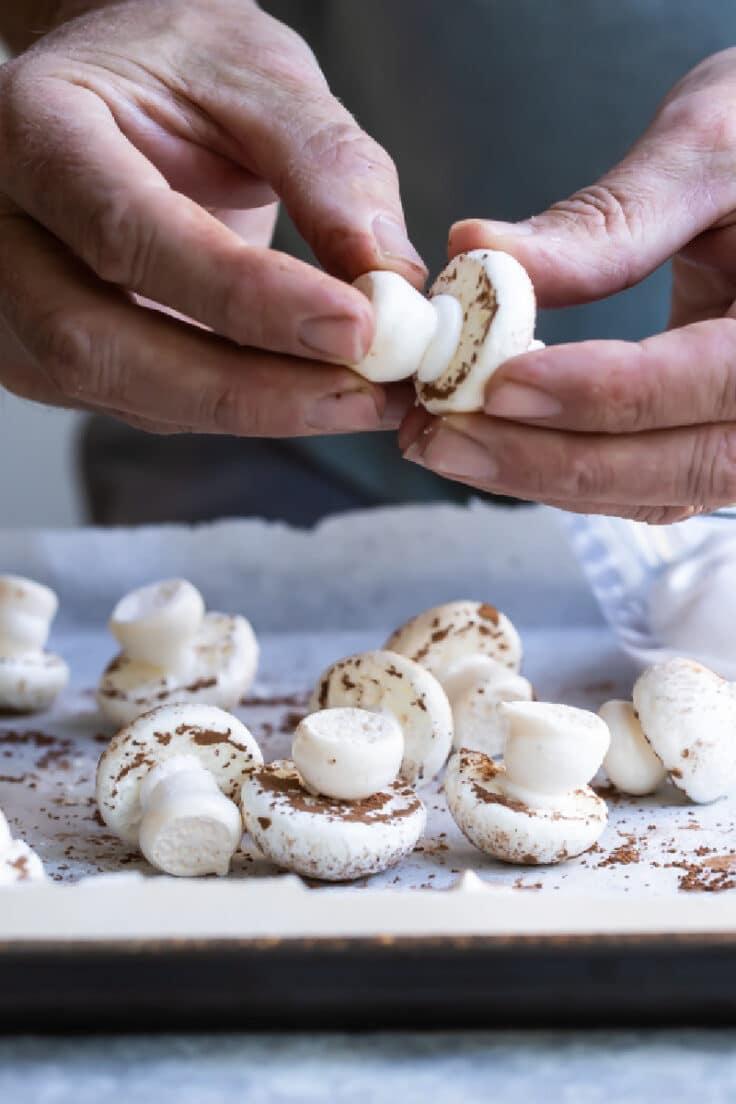 Assembling meringue mushrooms.