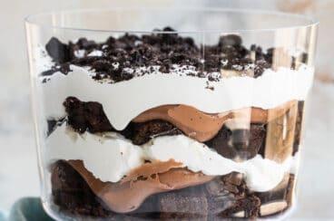 Oreo brownie trifle assembled in a trifle dish.