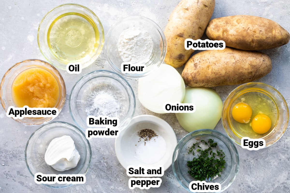 Labeled ingredients for potato latkes in various bowls.