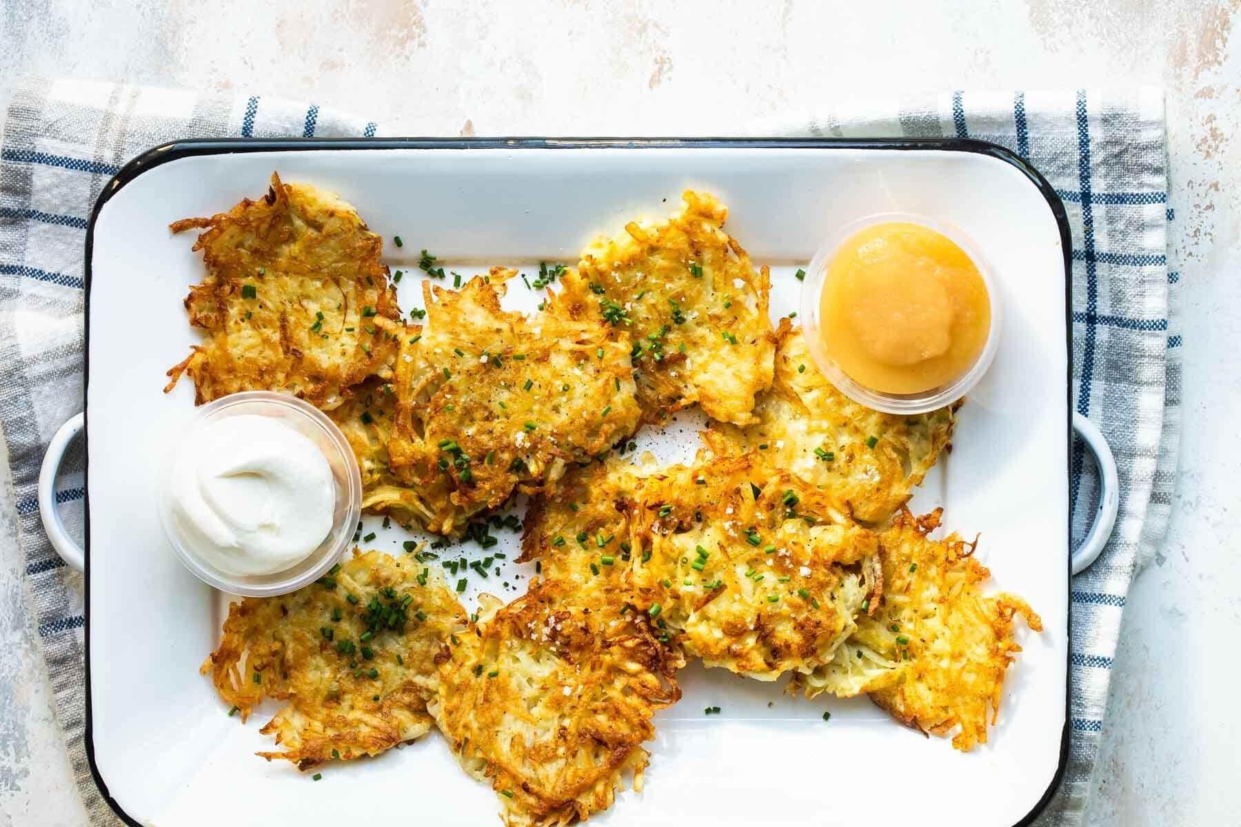 Potato latkes on a rectangular platter.