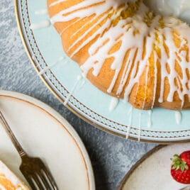 Lemon bundt cake slices on plates.