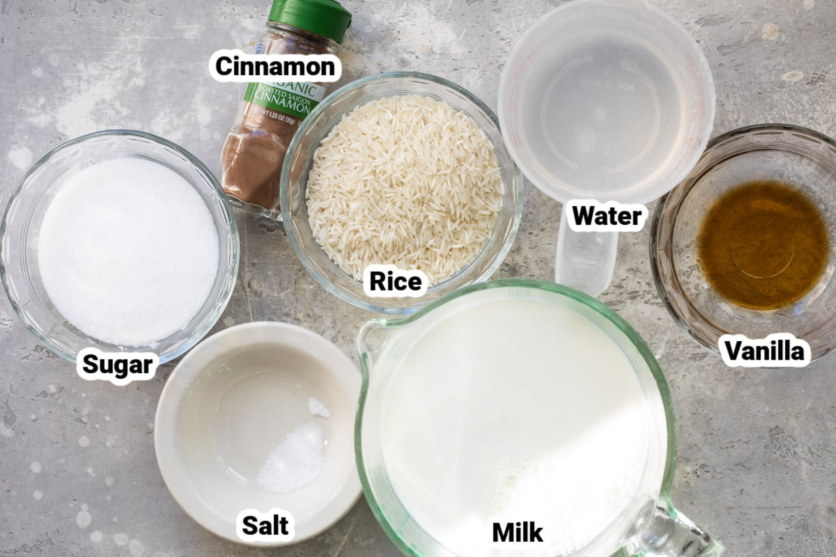 Labeled ingredients for rice pudding in various bowls.