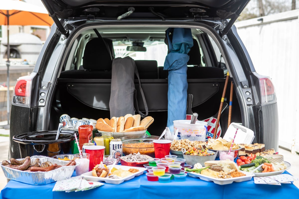 A tailgating spread set up at the back of a car.