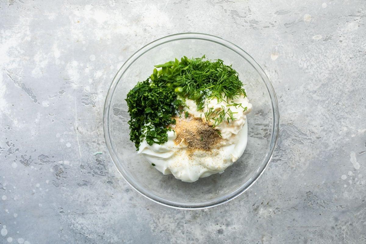 Veggie dip ingredients in a bowl before being mixed.