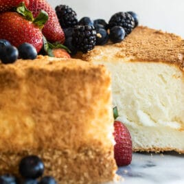 Angel food cake with fresh berries on top.
