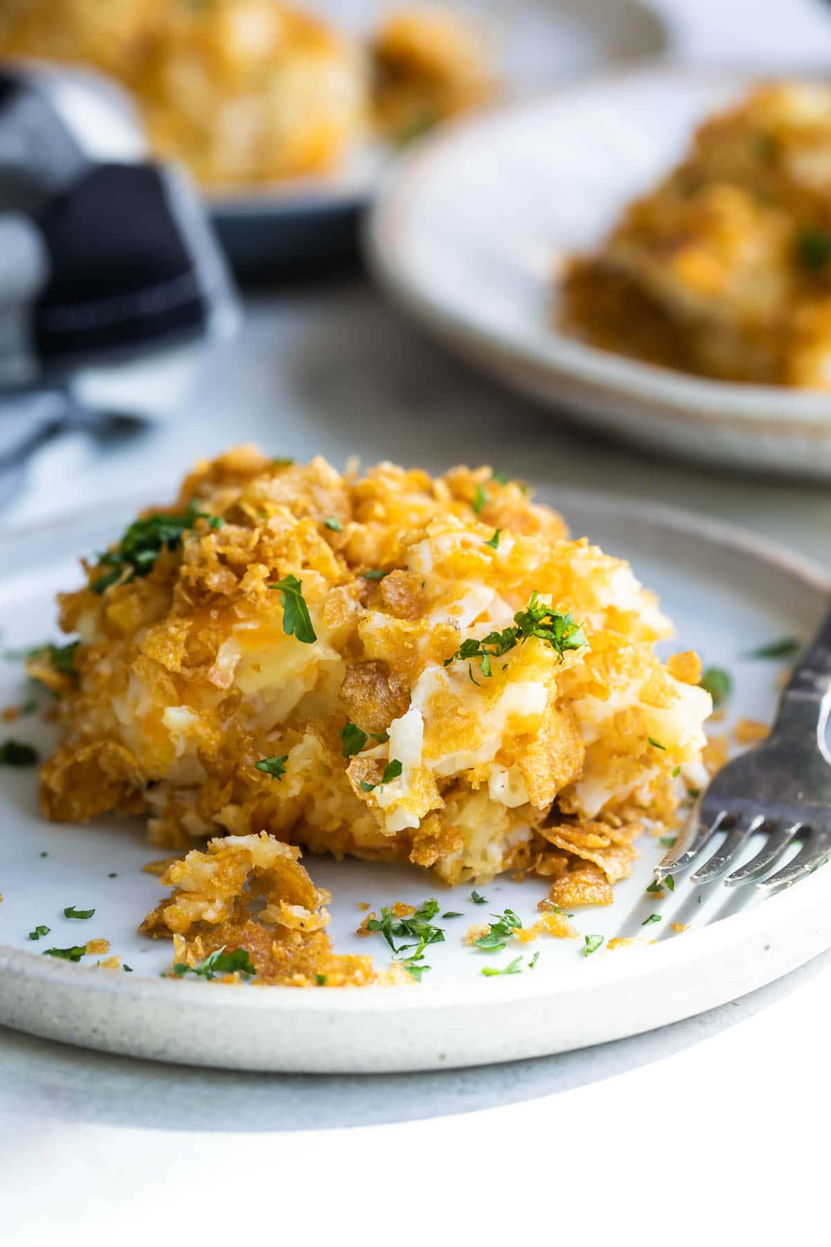 A pile of cheesy potato casserole on a plate.