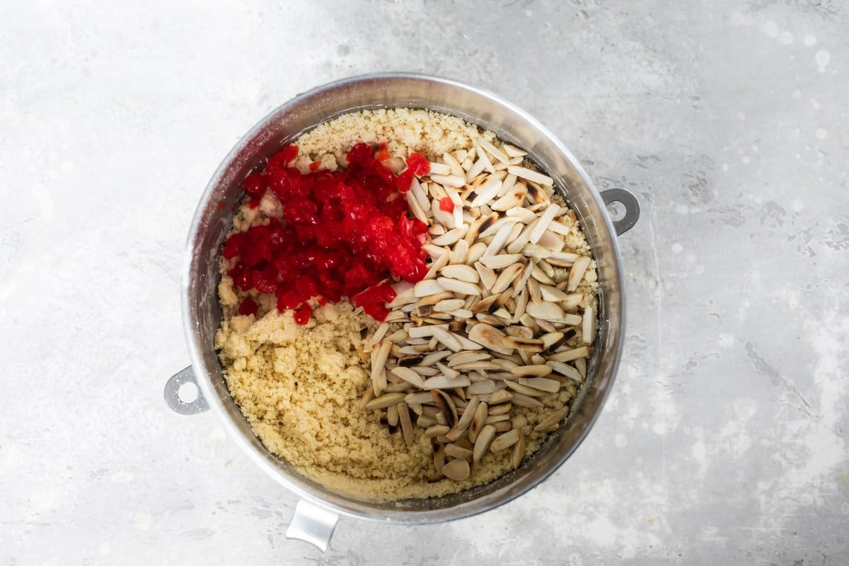 Ingredients for cherry almond biscotti in a mixing bowl.