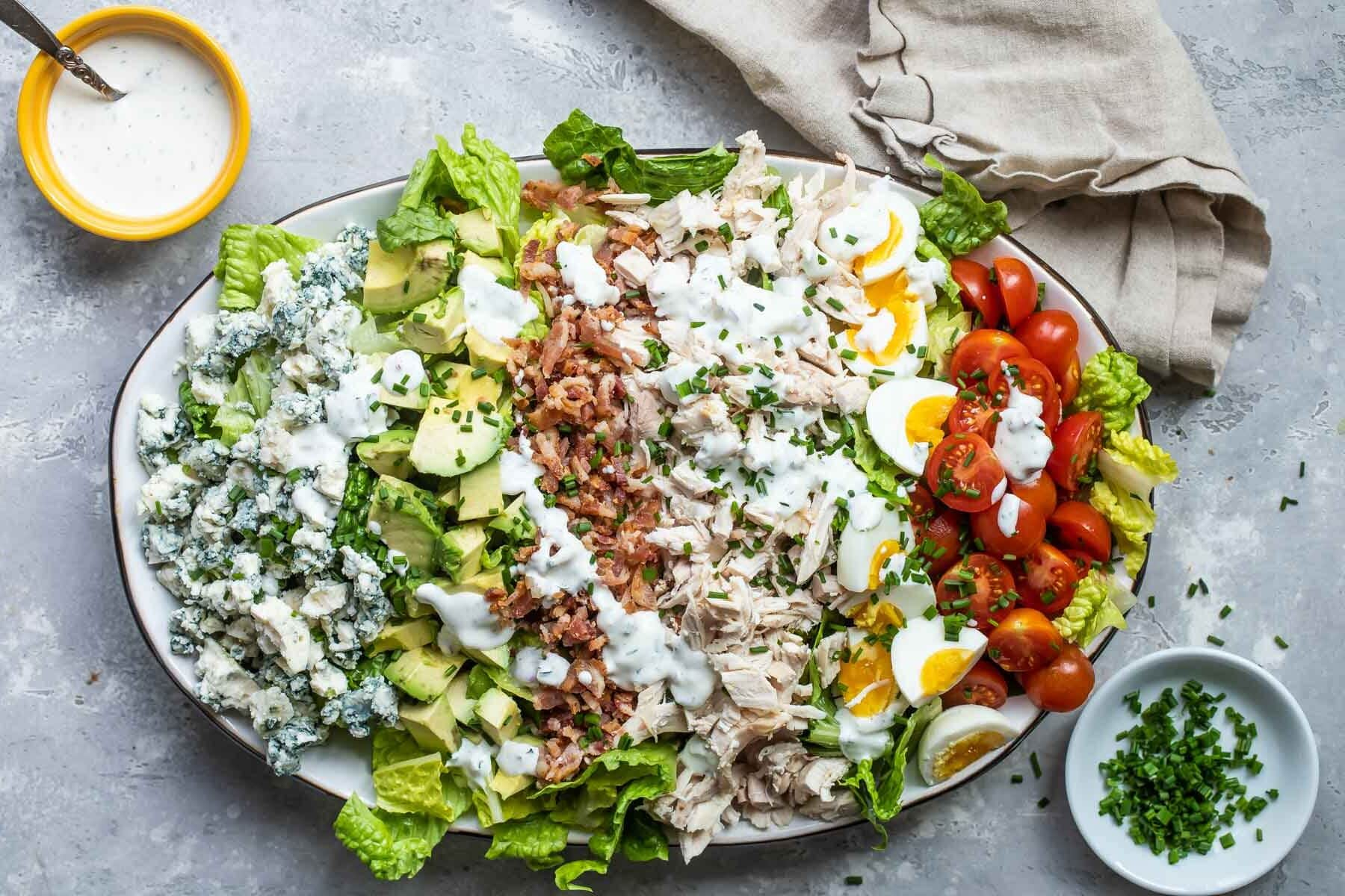 A cobb salad composed on a platter.