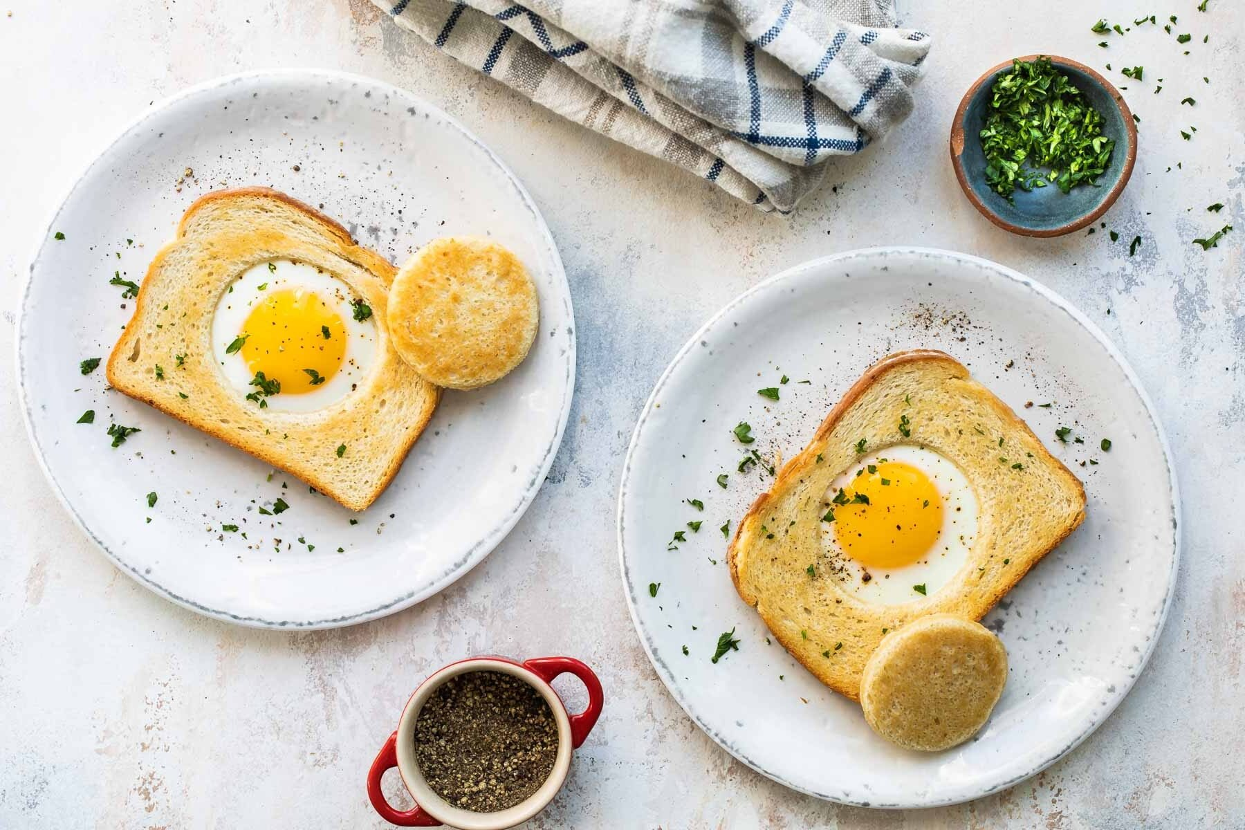 An egg cooked into a piece of bread.